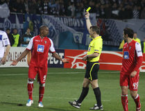 Referee shows the yellow card Royalty Free Stock Photos