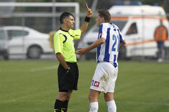 Referee shows the yellow card Stock Images