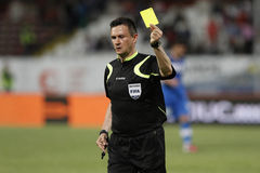 Referee shows the yellow card. Football referee, Cristian Balaj, shows the yellow card in the match between Dinamo Bucharest and Viitorul Constanta, Romania Royalty Free Stock Image
