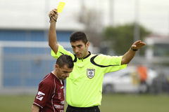 Referee shows the yellow card Stock Photography
