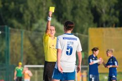 The referee shows a yellow card Stock Photo