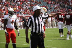 The referee  signals a penalty against the defense Royalty Free Stock Photography