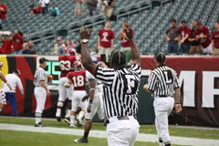 The referee signals for a touchdown Royalty Free Stock Photo