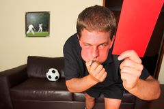 Referee in sitting room blowin Stock Photography