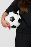 Referee with a soccer ball Stock Photo