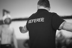 Referee stopping the fight Royalty Free Stock Image