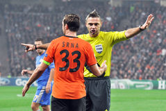 The referee talks with the captain of Shakhtar Royalty Free Stock Photography