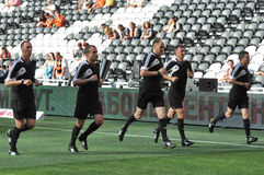 Referee team warms-up Royalty Free Stock Photos
