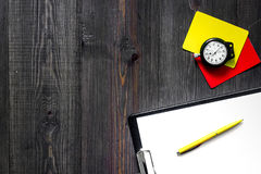 Referee tools. Yellow and red referee cards, whistle, stopwatch, pad, pen on wooden background top view copyspace Stock Photography