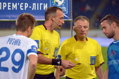 Referee and two captains Royalty Free Stock Image