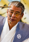 A referee watching two spiders fight. Kajiki, Kagoshima prefecture, Japan, June 15, 2008, A referee watches two St. Andrew's Cross spiders fighting at the Kajiki royalty free stock photography
