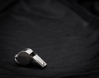 Referee whistle. On black background Royalty Free Stock Photos
