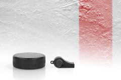 Referee whistle, the puck and hockey field Stock Images