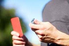 Referee with whistle and red card at soccer game Stock Image