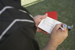 Referee Writing In His Report Book Royalty Free Stock Photography