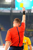 Referee and yellow card Stock Photography