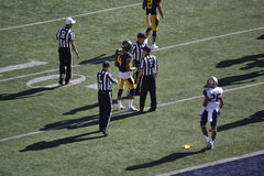 Referees and Cal Football Players. Referees and Cal Berkeley football players on the field. Photo taken on Saturday, October 11 at California Memorial Stadium Stock Photos