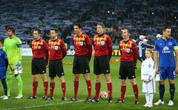Referees and captains standing in line before UEFA Europa League Round of 16 second leg match between Dynamo and Everton. KYIV, UKRAINE - MARCH 19, 2015 Stock Photos
