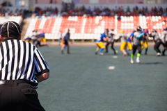 Referees closely watching teams players Royalty Free Stock Photos