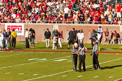 Referees at College Football Game. Tallahassee, FL, USA - Oct. 22, 2011:  Referees take to the field for the start of the Florida State vs. Maryland football Royalty Free Stock Images