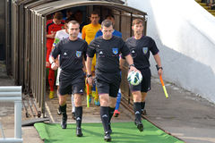 Referees are coming out on the field Stock Images
