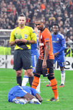 Referees and Fernandinho look at footballplayer Stock Photos