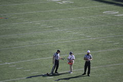 Referees Pause for a Water Break. Referees stop for a water break at California Memorial Stadium at a Cal UC Berkeley during a football game on Saturday, October Stock Photos