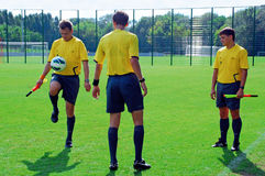 Referees play with ball. During third-place match between Real Madrid and Inter Milan in International Youth Football Tournament U-17 08/19/2012 stadium Kirsha Stock Photos