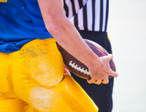 Are referees and player holding the ball in his hands Stock Images