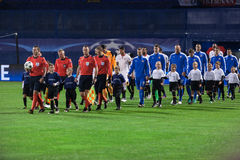 Referees, players and kids entering pitch. Stock Images