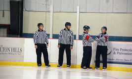 Referees taking a break. Four Ontario Junior A hockey officials take a break before the Georgetown Raiders home opener. September 16, 2009 Stock Photo
