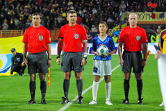 Referees team at the match beginning. Referees team at the match between Romania and Faroe Islands, 14.10.2009 Royalty Free Stock Photo