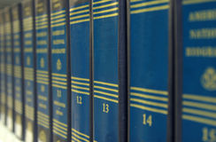 Reference books. Row of books, shallow dof, with the three books in focus blank for text stock image