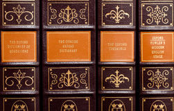Reference books. Leather bound books including a thesaurus, dictionary royalty free stock photography
