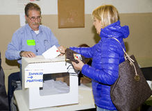 Referendum in Catalonia. BARCELONA - NOVEMBER 9: Unidentified woman votes in symbolic referendum on Catalonia independence, in defiance of the central government Royalty Free Stock Photo