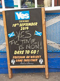 Referendum day in Inverness. High Street Inverness on referendum day, 18th September 2014 with pro Independence advert outside pub and quote from Scottish poet Stock Photos