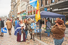 Referendum day in Inverness. High Street Inverness on referendum day, 18th September 2014 with pro Independence stall and suggestion of historic battles Stock Photo
