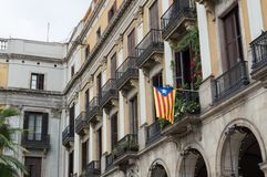 Referendum of independence from Spain. Catalan flag, Senyera hanging from the balcony.  Royalty Free Stock Photography