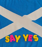 Referendum: say yes campaign. The Scottish flag, the Saltire, with text message saying  ' say yes ' in colorful upper case letters Stock Photography
