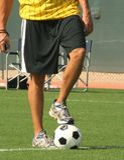 Referent mit der Fußballkugel Lizenzfreies Stockbild