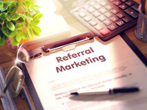 Referral Marketing on Clipboard. 3D. Office Desk with Stationery, Calculator, Glasses, Green Flower and Clipboard with Paper and Business Concept - Referral royalty free stock photos