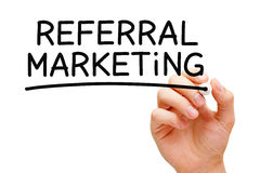 Referral Marketing. Hand writing Referral Marketing with black marker on transparent wipe board royalty free stock photos