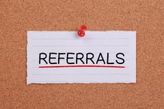 Referrals Concept Note. Paper pinned on corkboard stock images