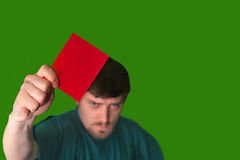 REFERY. An image of a man showing a red card Stock Images