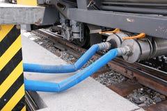 Refill the brake fluid in a railway carriage Stock Photos