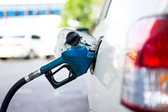 Refill fuel to a car at gas station Royalty Free Stock Photography