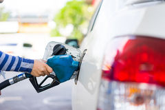 Refill fuel to a car at gas station Stock Photos