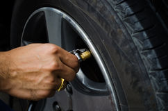 Refilling air into a car tyre royalty free stock photos