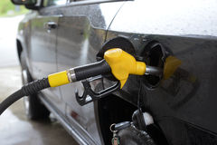 Refilling up gas tank of the car Stock Photos