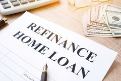 Refinance home loan application. Refinance home loan application on a desk stock photography